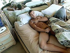 Gay bear Victor Rios starts his morning right by stroking his erect hard cock in bed