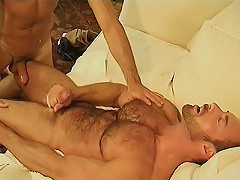 Horny bear Eric Evans giving his huge cocked gay partner a hot indoor bareback ride