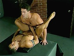 Hot bears Max Grand and Paul Carrigan on a hardcore bareback gay sex on a table