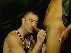 Gay bear Max Grand enjoys some kinky roleplaying as he sucks off a chained hunk
