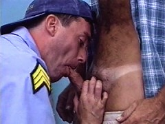 Cop gets dirty with some laborers